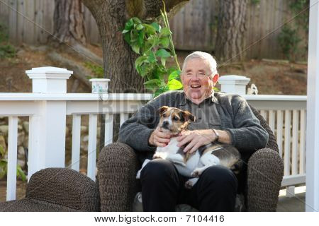 Happy Elderly Man With Dog