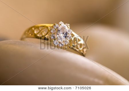 Beautiful  gold ring with rocks and hemp.