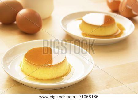Shiny Caramel custard on light wooden table