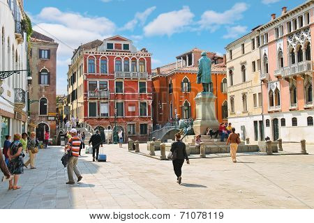 Tourists On The Square Near The Monument Manin In Venice, Italy