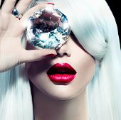 High fashion portrait of beauty model girl with a big diamond. Luxury make-up and accessories, white smooth shiny hair, red sensual lips poster