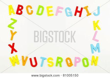 Alphabet Magnets Forming Frame On Whiteboard