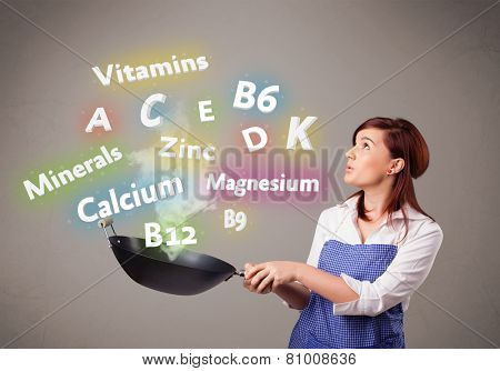 Pretty young woman cooking vitamins and minerals poster