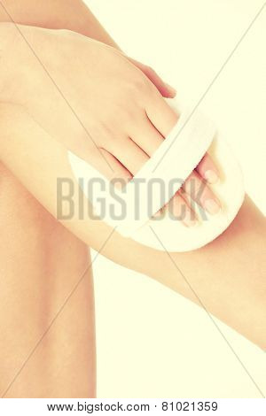 Beautiful and smooth female's leg being pampered. Spa concept.