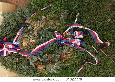 Firry wreath decorated with Czech national ribbons.