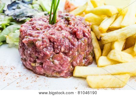 tasty Steak tartare (Raw beef) - classic steak tartare on white plate poster