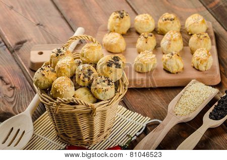 Cheesy Bites with garlic blue cheese sprinkled with poppy and sesame seeds poster
