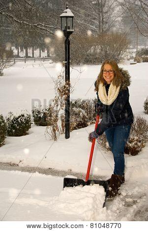 Shoveling Snow Girl At Top Of Driveway