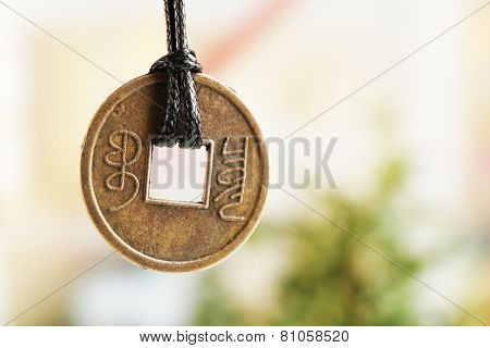 Feng shui coin on light background poster