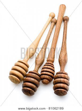 Carving wooden honey dipper spoon isolated on white background cutout