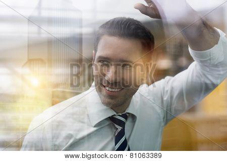 Businessman Standing Behind Glass