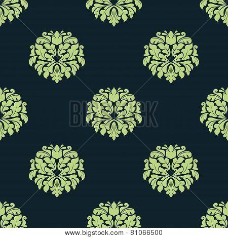 Seamless green colored damask pattern