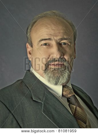 Mature Man In Suit Jacket And Tie