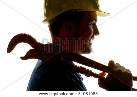a worker in an industrial enterprise (craftsmen) with tools in hand