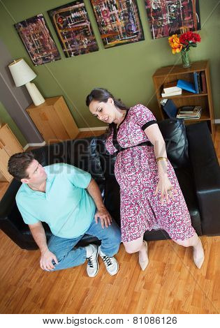 Man Looks At Clumsy Pregnant Woman