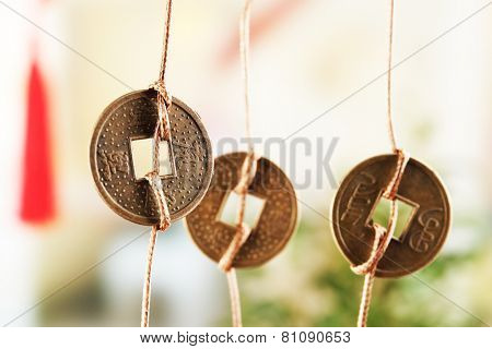 Feng shui coins on light background