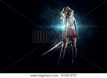 Young sexy girl is standing with the swords