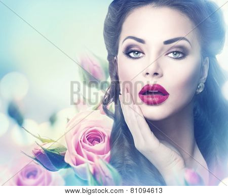 Retro woman portrait in beauty pink roses. Beautiful Vintage styled girl with flowers. Perfect makeup and hairstyle. Gorgeous model lady. Red Lips. Beautiful Luxury Make up and Hair. Vogue Style