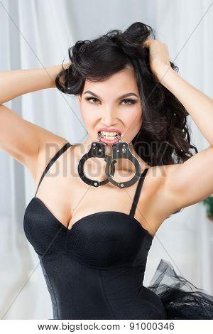 Woman in underwear, bite handcuffs, sex games poster