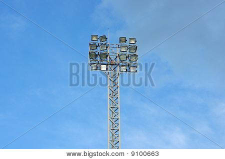 a football stadium floodlight , blue sky