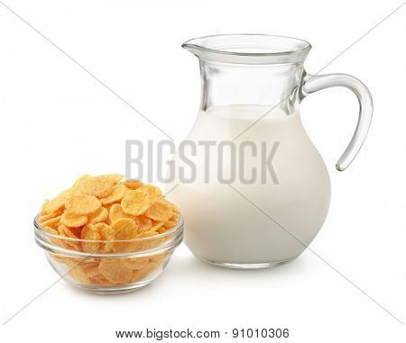 Corn flakes and jug of milk isolated on white