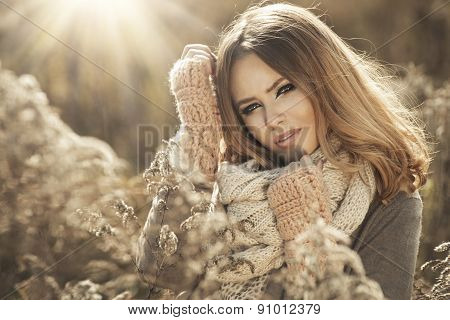 Young Girl  In Autumn Scenery