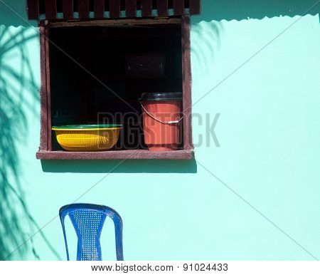 Bright Colored Dishes In Open Window