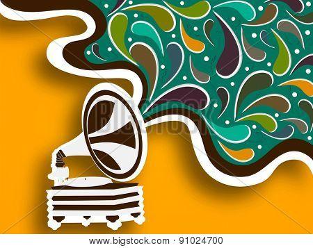 Retro musical instrument (gramophone) on stylish background.