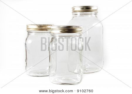 Three Glass Mason Jars On An Isolated Background