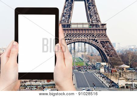 travel concept - tourist photograph Champ de Mars Pont d Iena and Eiffel Tower in Paris France on tablet pc with cut out screen with blank place for advertising logo poster