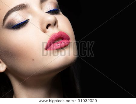 Beautiful woman with evening make-up and pink lips. Beauty face.