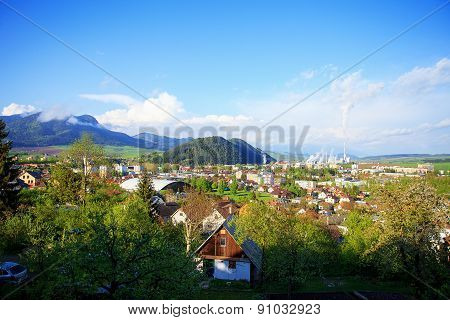 Industrial Refinery Plant In A Natural Environment And Mountain A Town, View Of A Factory In The Lan