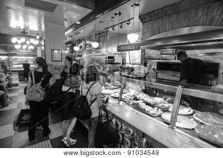 NEW YORK - SEPTEMBER 25, 2011: costumers in Sbarro pizza. Sbarro, LLC is a chain of pizza restaurants that specializes in New York style pizza and other Italian-American cuisine.