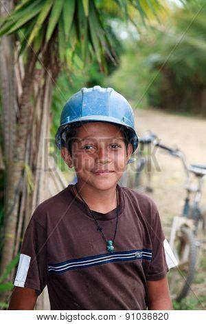 Young Honduran Boy Wearing A Construction Hard Hat