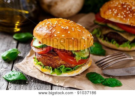 Vegetarian burger with grilled champignon, tomato and cucumber. poster