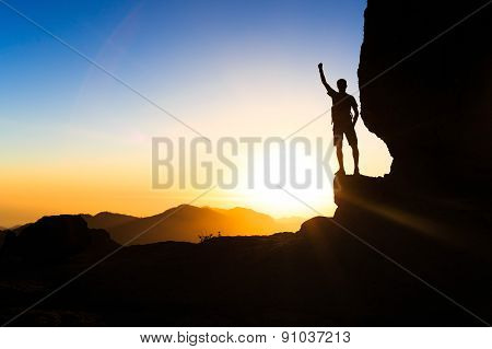 Man Hiking Climbing Silhouette Success In Mountains Sunset