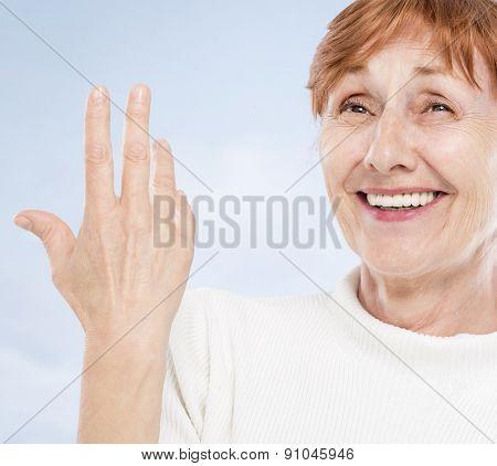 Self confident senior woman on seaside
