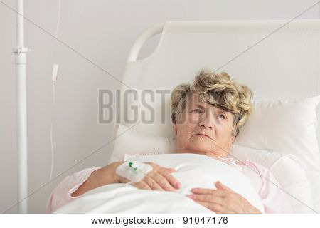 Aged Woman With Intravenous Cannula