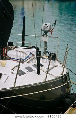 black sailboat in slip