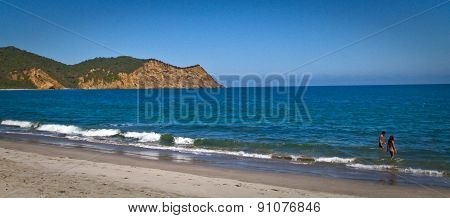 Unidentified tourists enjoying the beautiful ecological Los Frailes beach, Machalilla National Park,