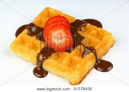 Waffle With Strawberry Slices And Chocolate Sauce