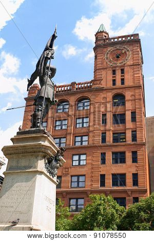 Maisonneuve monument built in 1895 in memory of Montreal founder Paul Chomedey de Maisonneuve by Louis-Philippe Hebert in Place d'Armes in Old Montreal. Behind the statue the New York Life Building built between 1887 and 1889 in Montreal Quebec Canada.