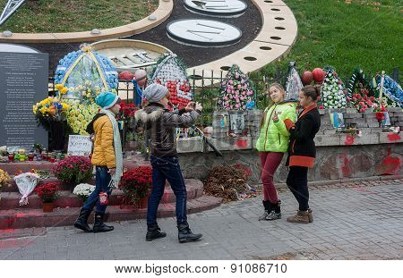 Kiev; Ukraine - October; 22; 2014: Teens Are Photographed On Alley Memory Of Those Killed In The Cou