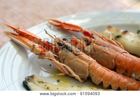 grilled fish with two prawns in the restaurant