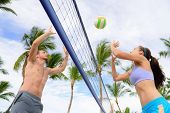 Friends playing beach volleyball sport. Woman and man having fun recreational volley ball game in summer living healthy active sport lifestyle. poster