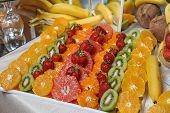 Carved fruits arrangement. Fresh various fruits. Assortment of exotic fruits. Fresh fruits decoration poster