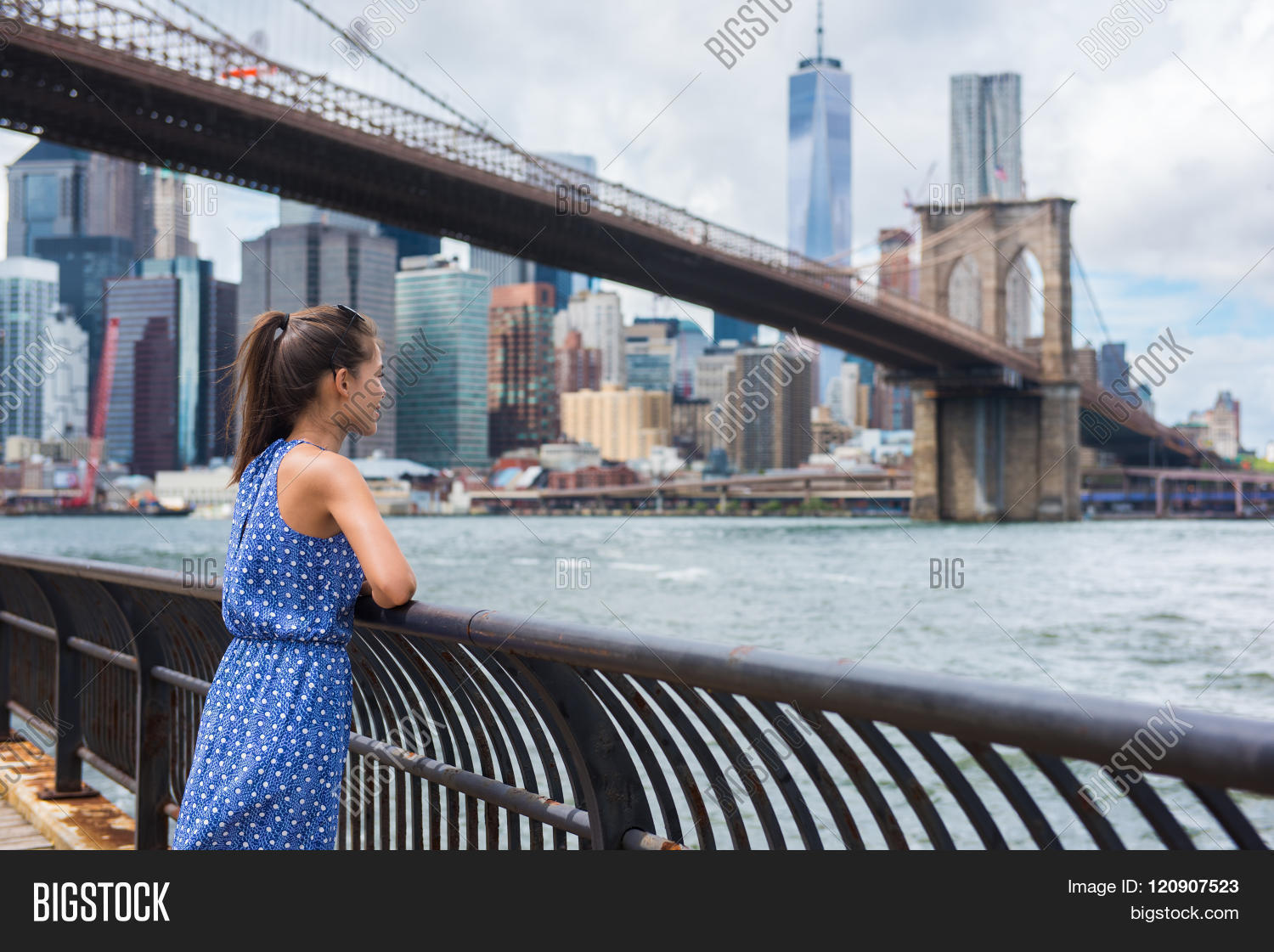 New York city urban woman enjoying view of Brooklyn bridge and NYC skyline  living a happy