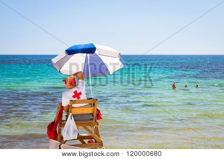 Sunny Mediterranean Beach, Lifeguard Sitting In Observation Post, Cala Del Palangre, Torrevieja, Spa