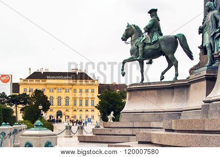 Tourists near MuseumsQuartier Wien and part of Maria TheresiaMonument in Vienna, Austria