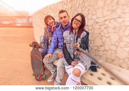 Best Friends Using Selfie Stick Making Funny Faces - Concept Of Friendship And Travel With Young Peo